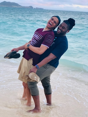 Mario and Monte Foreman-Powell pose for a photo together on vacation.