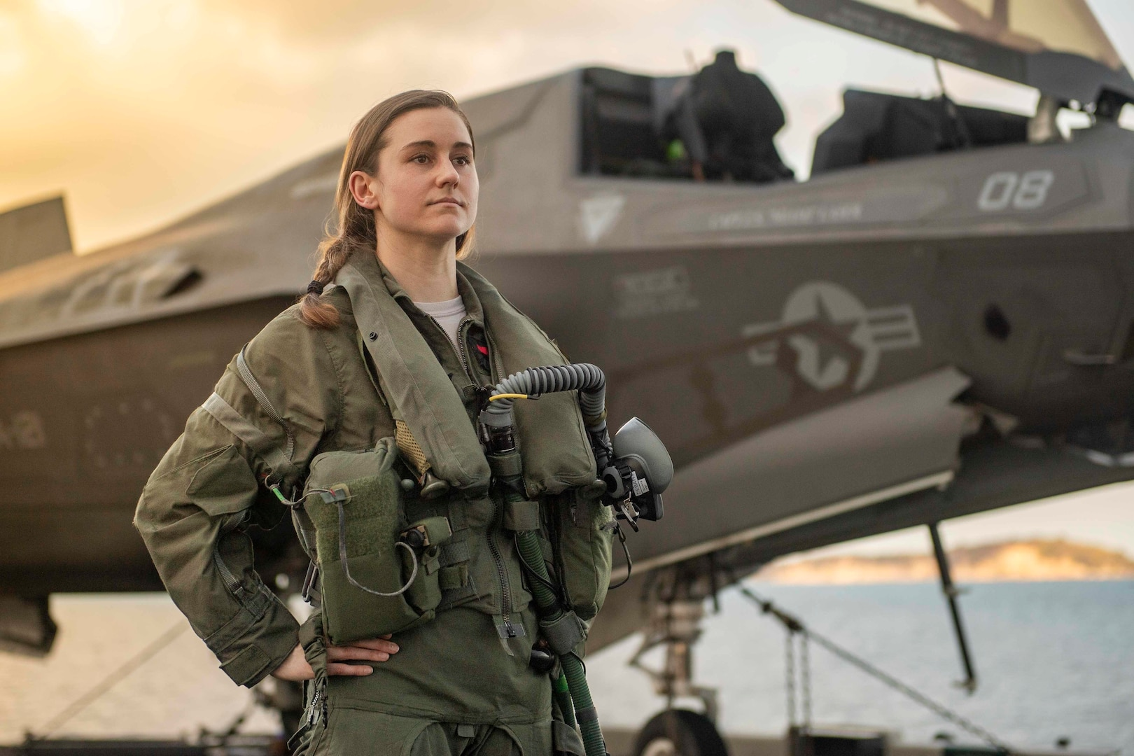 U.S. Air Force pilot Captain Melanie Ziebart, one of six Air Force pilots flying F-35B Lightning II stealth multirole fighters in Marine squadrons to disseminate inter-Service tactics and strengthen joint force capabilities, on flight deck of amphibious assault ship USS America, flies with 31st Marine Expeditionary Unit Marine Fighter Attack Squadron (VMFA) 121 Green Knights, Gulf of Thailand, March 7, 2020 (U.S. Navy/Jonathan Berlier)