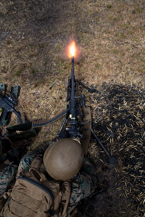 U.S. Marine Corps Pfc. Ryan Helm, a machine gunner with 2d Battalion, 6th Marine Regiment, 2d Marine Division, suppresses targets during range G-36 on Camp Lejeune, N.C., March 23, 2021.The Marines conducted the range to increase proficiency in fire and maneuver tactics. The range is a live-fire, company-sized attack range which includes automated targets for mortarmen, snipers, machine gunners, and riflemen to engage for a more realistic combat situation. (U.S. Marine Corps photo by Lance Cpl. Brian Bolin Jr.)