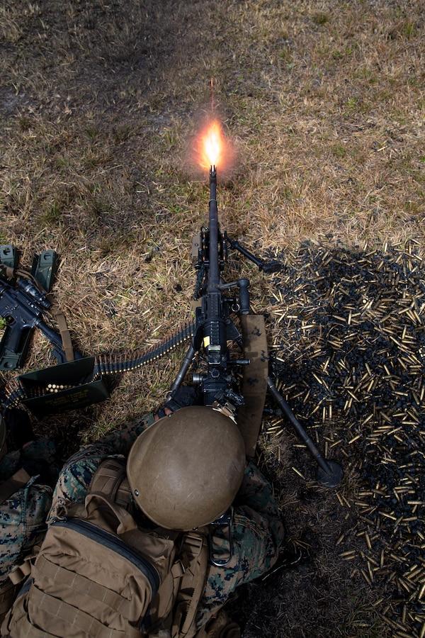 U.S. Marine Corps Pfc. Ryan Helm, a machine gunner with 2d Battalion, 6th Marine Regiment, 2d Marine Division, suppresses targets during range G-36 on Camp Lejeune, N.C., March 23, 2021.