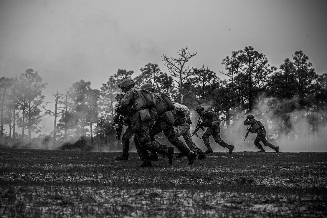U.S. Marines with 2d Battalion, 6th Marine Regiment, 2d Marine Division, assault a trench during range G-36 on Camp Lejeune, N.C., March 24, 2021. The Marines conducted the range to increase proficiency in fire and maneuver tactics. The range is a live-fire, company-sized attack range which includes automated targets for mortarmen, snipers, machine gunners, and riflemen to engage for a more realistic combat situation. (U.S. Marine Corps photo illustration by Lance Cpl. Brian Bolin Jr.)