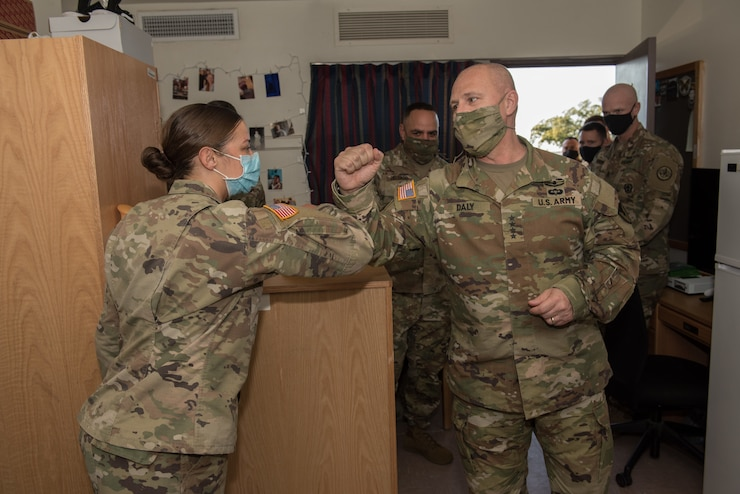 Gen. Ed Daly and Command Sgt. Maj. Alberto Delgado, the command team of Army Materiel Command, visit barracks at Fort Hood, Texas, to see quality of life improvements Dec. 2. AMC is responsible for four of the five quality of life priority initiatives set by the Chief of Staff of the Army: housing, child care, spouse employment and permanent change of station moves. (U.S. Army photo by Sgt. 1st Class Kelvin Ringold)