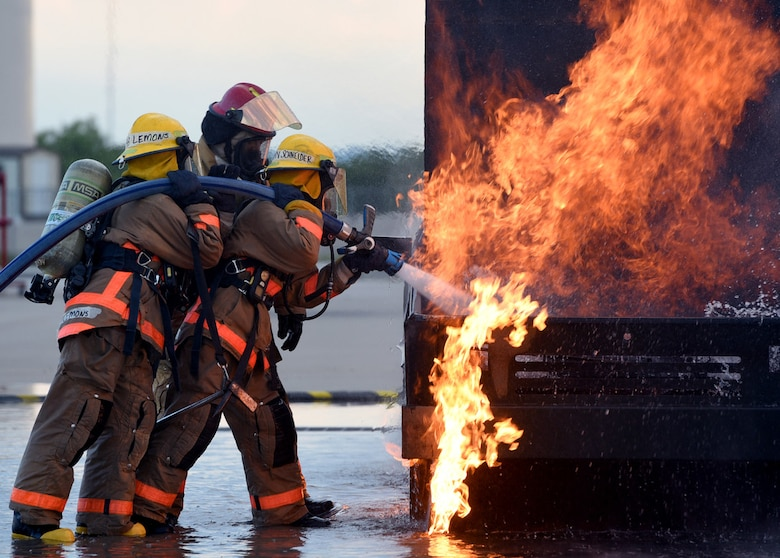 Image of fire fighters putting out fire during training.