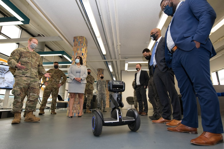 Second Lt. Johann Johnson, 436th Airlift Wing innovation lab director, briefs Delaware State University faculty and students on self-balancing transportation at the Bedrock innovation lab on Dover Air Force Base, Delaware, March 25, 2021. The lab staff plans to implement the autonomous unit to help with maintenance operations and inspections. (U.S. Air Force photo by Mauricio Campino)