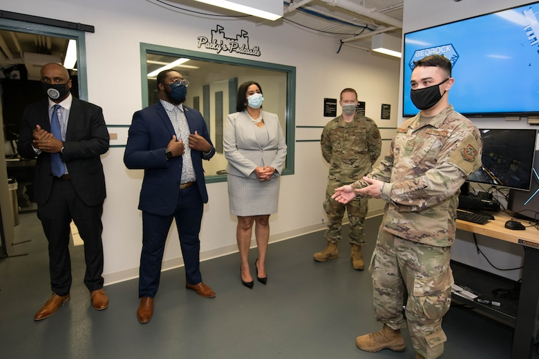 Staff Sgt. Alexander Feith-Tiongson, 436th Aircraft Maintenance Squadron innovation lab chief technology officer, briefs Delaware State University faculty and students on virtual and augmented reality capabilities and training tools at the Bedrock innovation lab on Dover Air Force Base, Delaware, March 25, 2021. Established in 2019, Bedrock's goal is empowering Airmen to develop ideas and leverage new technologies to support the warfighter at home station or downrange. (U.S. Air Force photo by Mauricio Campino)