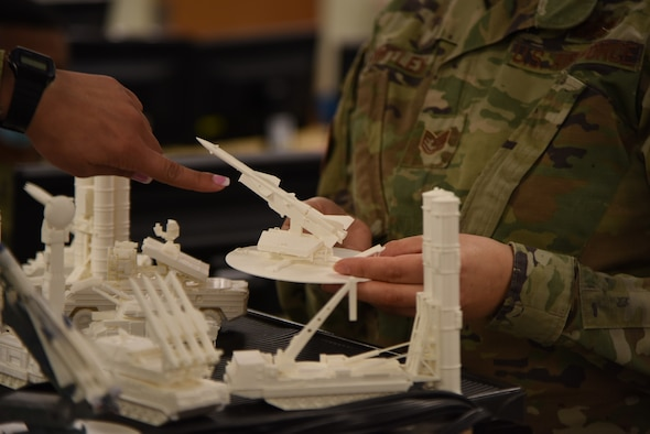U.S. Air Force Airman 1st Class Neisha Navarro Montanez, 315th Training Squadron student, discusses a three-dimensional model with Tech. Sgt. Mollie Whitley, 315th TRS instructor. The three-dimensional models were designed to help students in the geospatial intelligence course fully understand the types of equipment they have to recognize when looking at imagery. (U.S. Air Force photo by Senior Airman Ashley Thrash)