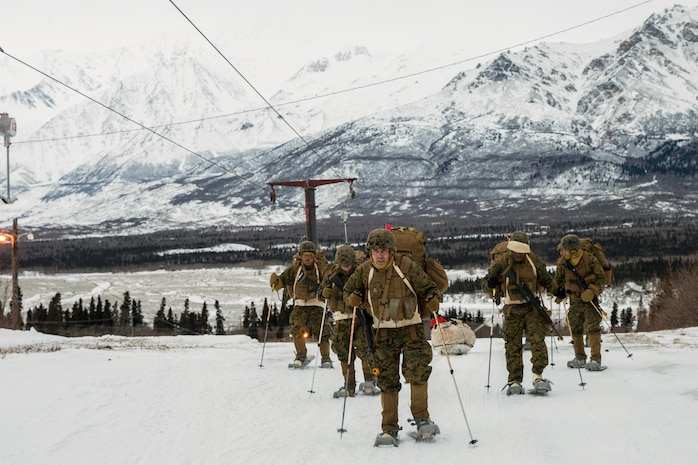 Marines with Combat Logistics Regiment 25, 2nd Marine Logistics Group, tow Ahkio sled containing cold weather gear, at U.S. Army Northern Warfare Training Center, Alaska, February 20, 2018 (U.S. Marine Corps/Sean M. Evans)