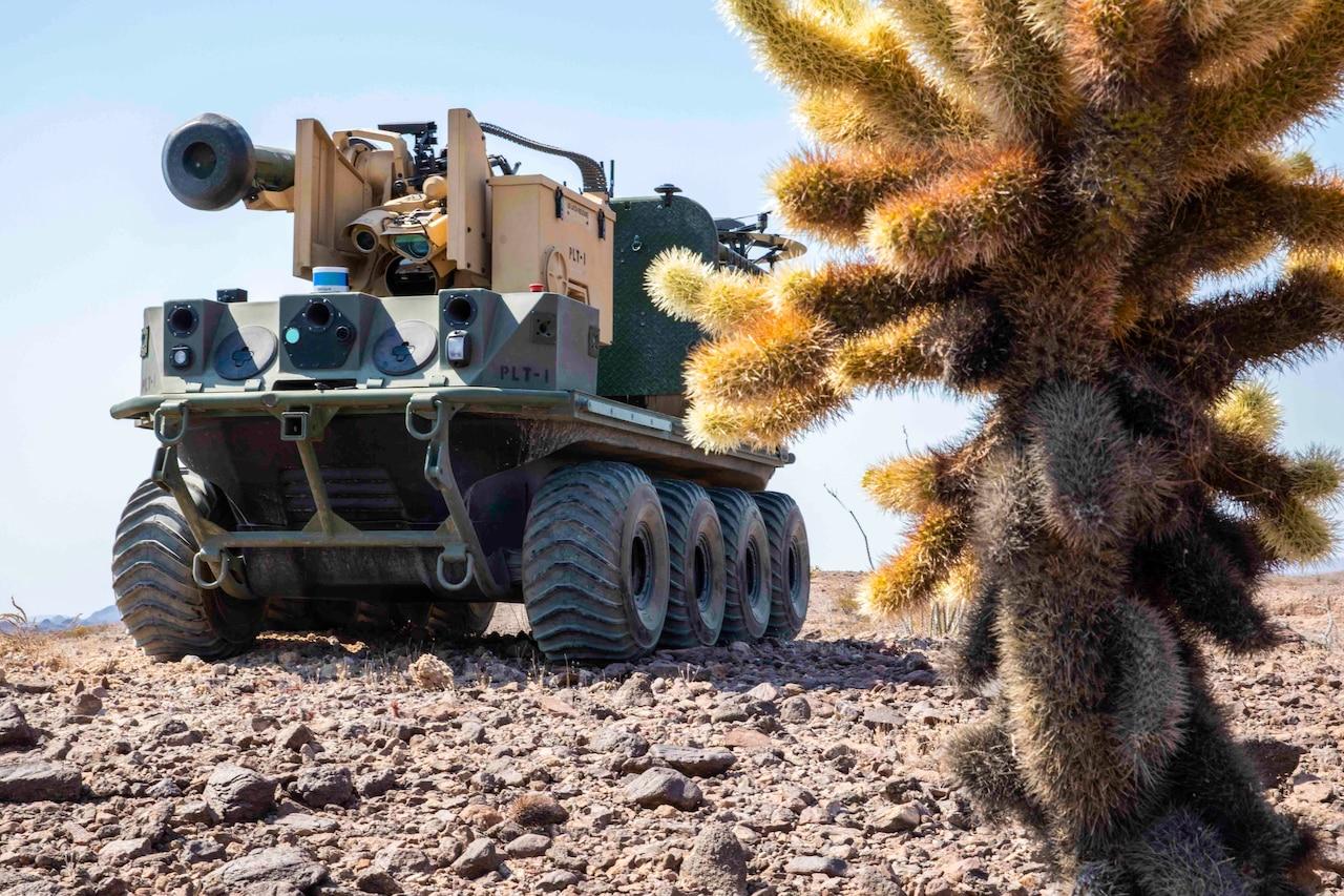 An autonomous vehicle drives across a desert floor.