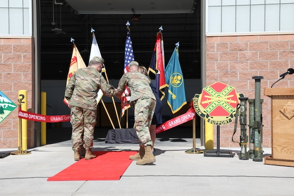 Army Maj. Gen. Matthew McFarlane, Commander, 4th Infantry Division, and several VIPs cut the ribbon to mark the opening of the new Ammunition Supply Point facilities on Fort Carson, CO, March 19