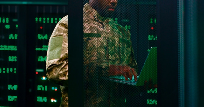 An Airman working on a computer