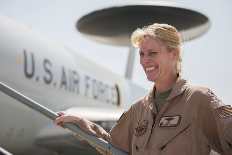 U.S. Air Force Col. Kristen Thompson, 380th Expeditionary Operations Group commander stands in front of an E-3 Sentry aircraft at Al Dhafra Air Base, United Arab Emirates, March 29, 2021. Thompson grew up in Anaheim Hill, California, before she attended the U.S. Air Force Academy as part of the class of 2001.  (U.S. Air Force photo by Staff Sgt. Zade Vadnais)
