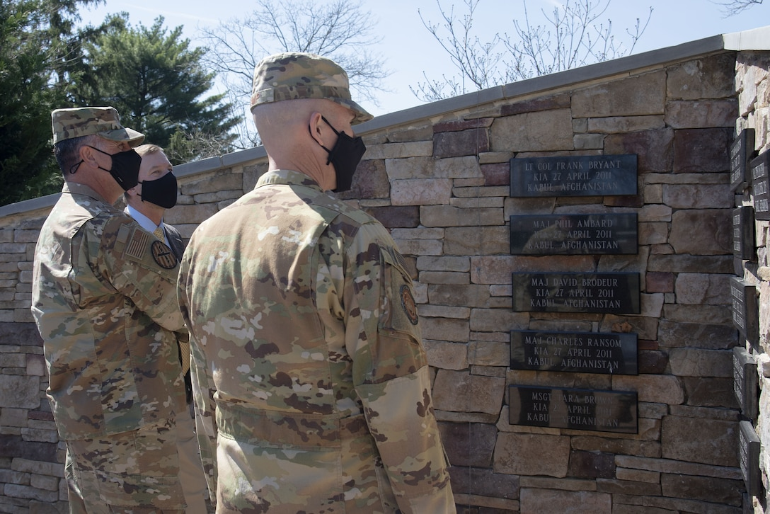 Photo of Airmen looking at the Air Advisor Memorial