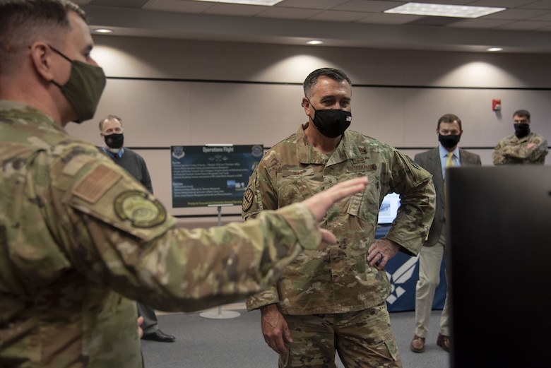 Photo of an Airman briefing a distinguished visitor