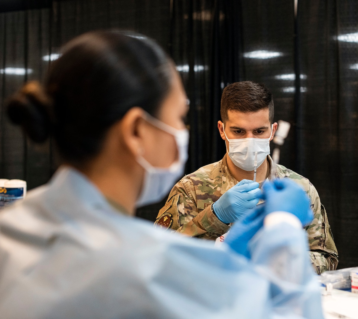 Air Force officer prepares COVID-19 vaccine.