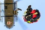 Firefighters with Mississippi Task Force Urban Search and Rescue ride hoist to UH-72 Lakota while participating in Patriot South 20, at Guardian Centers in Perry, Georgia, February 28, 2020 (U.S. Army National Guard/Christopher Shannon)