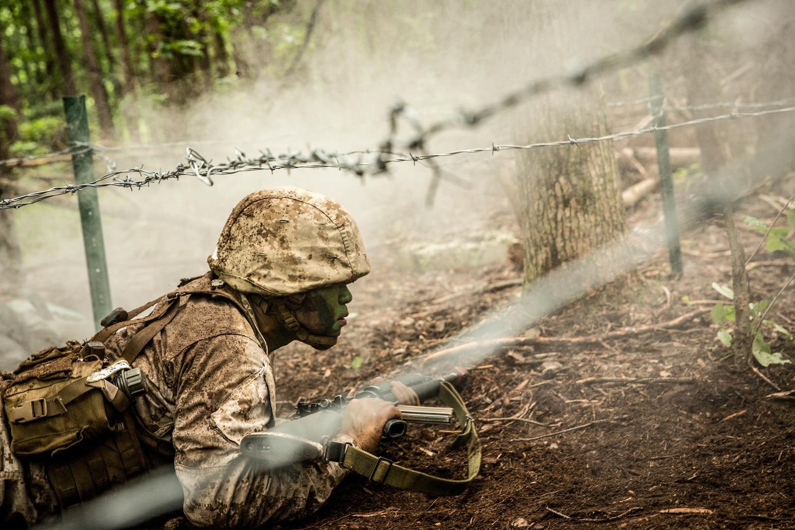 Marine Candidate participates in fire team assault course at Officer Candidates School, Marine Corps Base Quantico, Virginia, June 17, 2017 (U.S. Marine Corps/Cristian L. Ricardo)