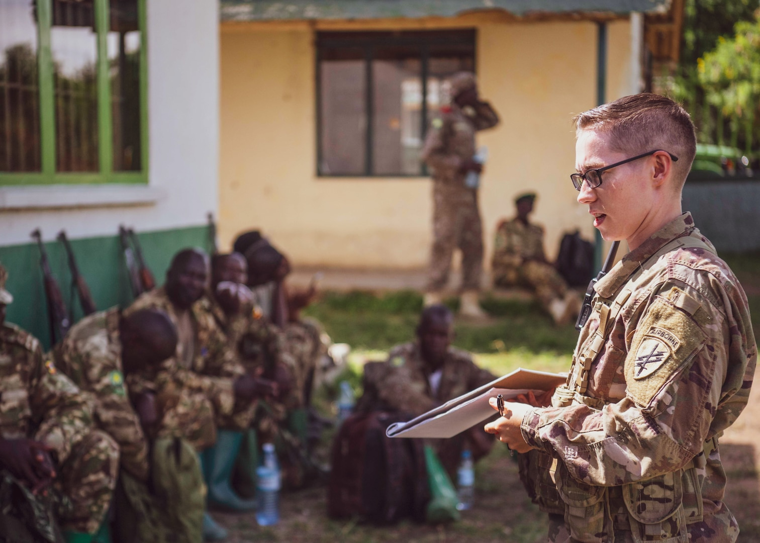 Army instructor with 403rd Civil Affairs Battalion, assigned to Combined Joint Task Force–Horn of Africa, writes team evaluation during Counter Illicit Trafficking Junior Leadership Course examination at Queen Elizabeth Park, Uganda, October 10, 2019 (U.S. Air Force/J.D. Strong II)