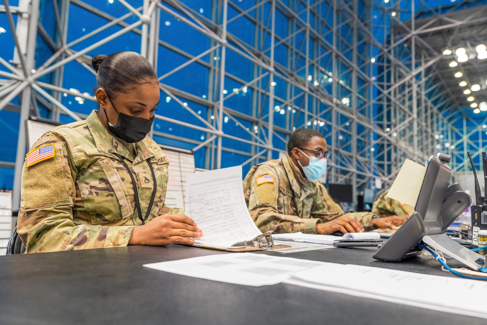 Soldiers prepare for next operational day in support of state efforts to provide mass COVID-19 vaccinations administered by New York State Department of Health, at Javits Convention Center in Manhattan, February 14, 2021 (U.S. Army National Guard/Sebastian Rothwyn)