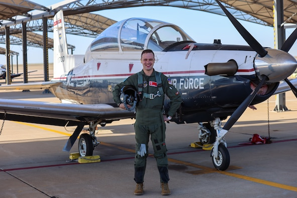 2nd Lt. Max Atkinson, 71st Student Squadron pilot in training, stands next to a T-6 Texan II at Vance Air Force Base, Oklahoma, March 31, 2021. Atkinson saved the life of a motorcyclist following a nearly fatal accident in mid-March. (U.S. Air Force/Courtesy photo)