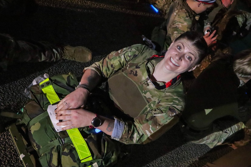 Despite having completed an 18.6 mile march carrying a 31 pound rucksack,  Sgt. 1st Class Kristen Bell, Civil Affairs Team Sergeant, 404th Civil Affairs Battalion (Airborne), is all smiles. Her time of 4 hours, 38 minutes earned her the Norwegian Foot March badge for wear on her Army Service Uniform.