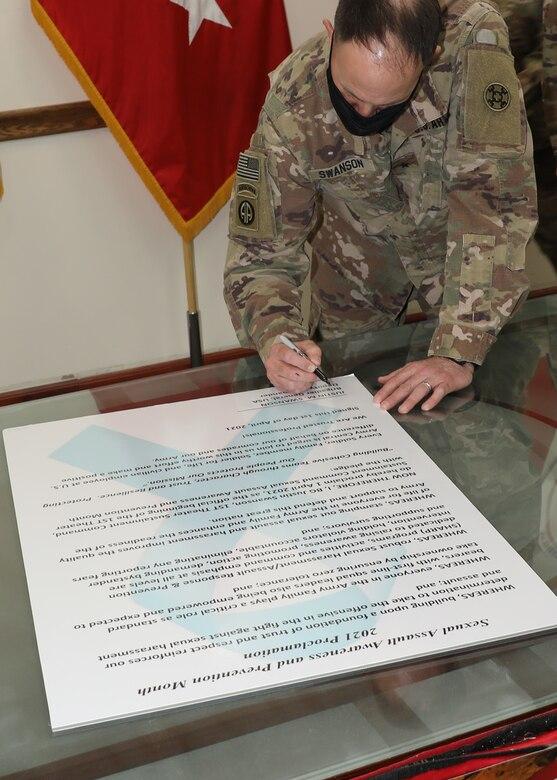 Army Reserve general signs April SAAPM proclamation at Camp Arifjan, Kuwait