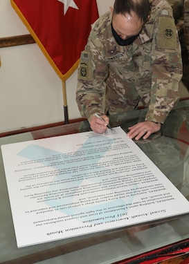 Army Reserve general signs April SAAPM proclamation at Camp Arifjan, Kuwait