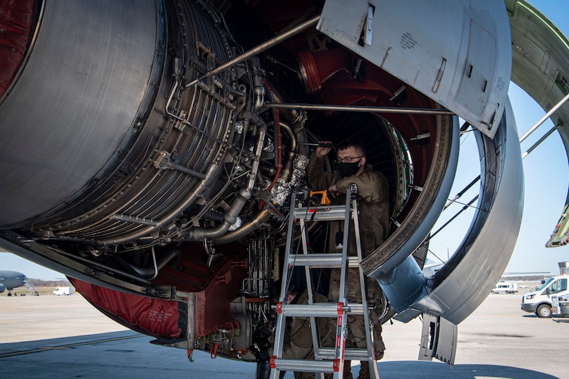 Photo of an Airman performing a borescope inspection on a KC-10 Extender compressor section.
