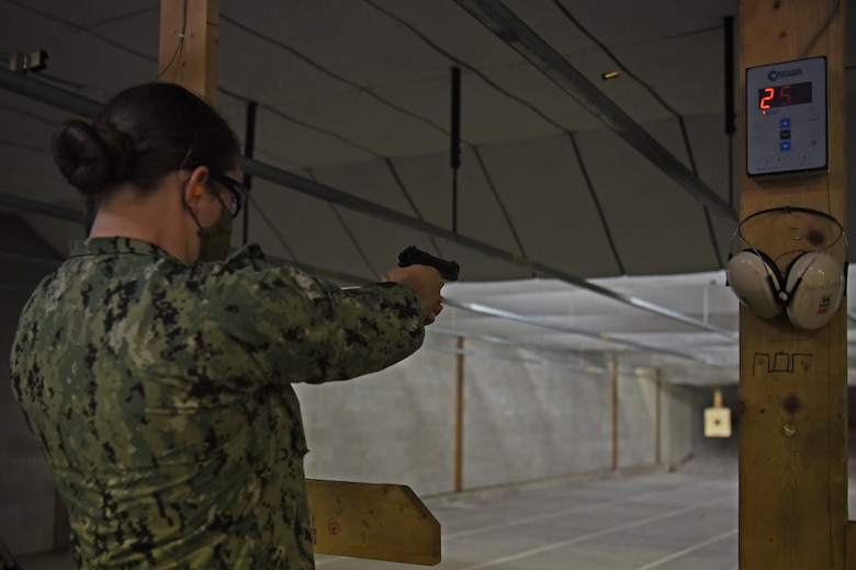 U.S. Navy Petty Officer 3rd Class Breanna Cherchio, Navy Center for Information Warfare Training Detachment Goodfellow cryptologic technician student, fires rounds during the Shooting in Excellence competition at the firing range, on Goodfellow Air Force Base, Texas, March 30, 2021.  Over 30 joint service members competed throughout a two-day period to win bragging rights and a pistol badge. (U.S. Air Force photo by Senior Airman Abbey Rieves)