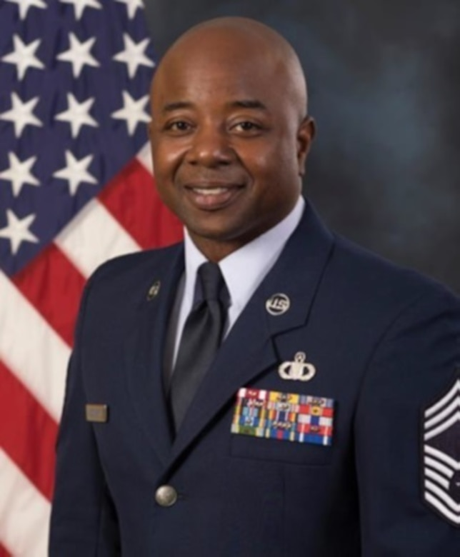 Chief Master Sgt. Raisean Lasenberry, Air Force Global Strike Command 608 Air Operations Center chief enlisted manager poses for an official photo in service dress uniform. (Courtesy photo)