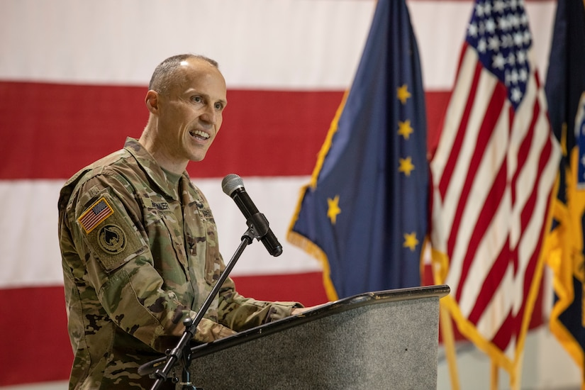 Col. Tim Brower, commander of 38th Troop Command, Alaska Army National Guard, gives a speech during a change of responsibility ceremony on Joint Base Elmendorf-Richardson, Alaska, March 30. Command Sgt. Maj. John Phlegar assumed the role as the senior enlisted leader from Command Sgt. Maj. Maureen Meehan, making Phlegar the senior noncommissioned officer in charge of the brigade. (U.S. Army National Guard photo by Edward Eagerton)