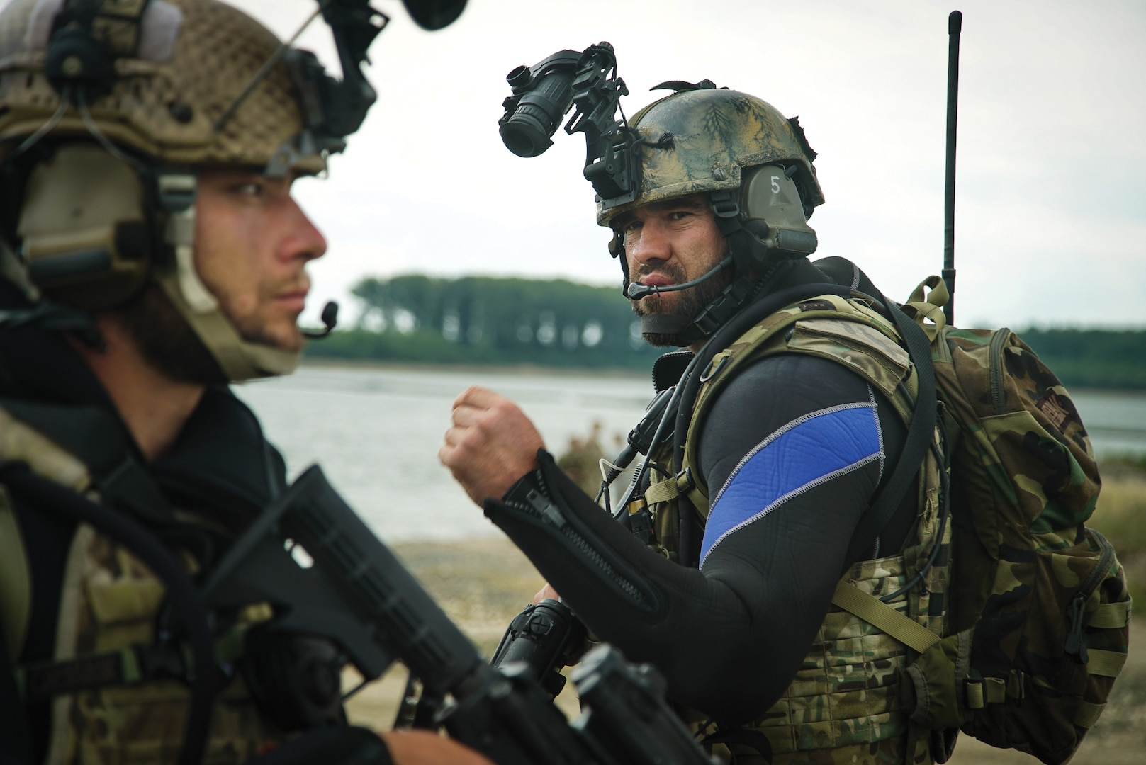 Waterborne Romanian troops prepare to move