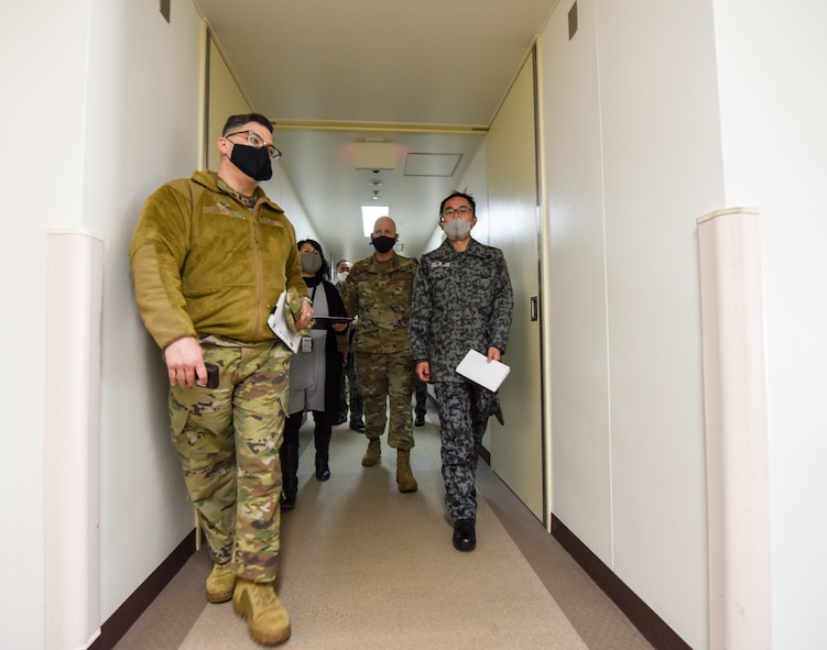 U.S. Air Force Master Sgt. William Castro, left, 35th Civil Engineer Squadron Unaccompanied Housing superintendent, leads a tour of the 35th Fighter Wing Unaccompanied Housing dormitory campus at Misawa Air Base, Japan, Feb. 26, 2021. As they are in the process of upgrading their unaccompanied housing living quarters, the Japan Air Self-Defense Force leaders from the 3rd Air Wing took the tour to gain some perspective on how the 35th Fighter Wing manages its dormitory campus. (U.S. Air Force photo by Tech. Sgt. Timothy Moore)