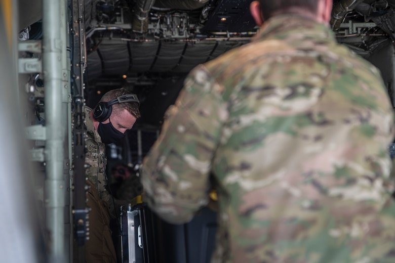 A photo of Airmen loading cargo