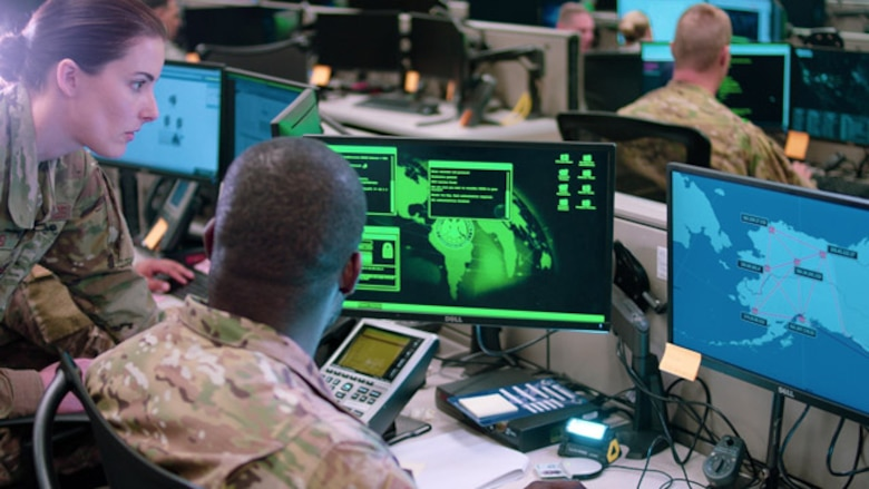 Capt. Sarah Miller and Tech. Sgt. Carrol Brewster, 834th Cyber Operations Squadron, discuss options in response to a staged cyber attack during a drill in June 2019. The Enterprise IT-as-a-Service Integrated Program Office, headquartered at Hanscom Air Force Base, Mass., stood up a Security Operations Center in San Antonio in late February to provide increased cyber threat detection for Buckley Garrison, Colorado, and Offutt Air Force Base, Nebraska. (U.S. Air Force Photo by Maj. Christopher Vasquez)
