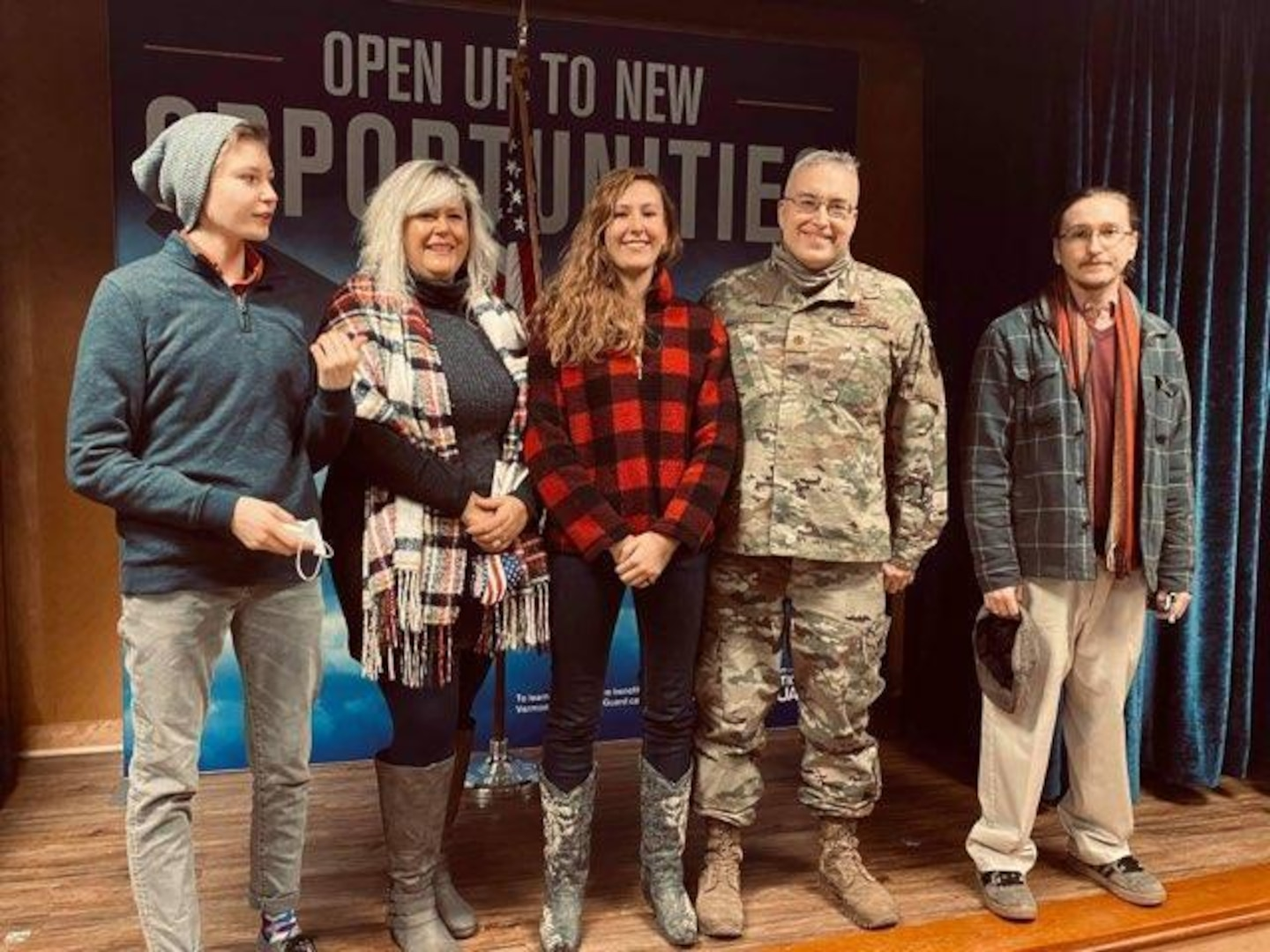 Maj. Jack Skoda, assigned to the 158th Fighter Wing, stands for a portrait with his family and daughter, Krystin, after she enlisted at the Vermont Air National Guard base