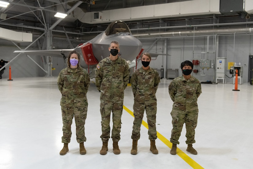 U.S. Army General Daniel R. Hokanson, chief, National Guard Bureau, stands for a portrait alongside Staff Sgt. Sara Basiliere, Master. Sgt. Jessica Mitchell and Master Sgt. Mare Jane Palumbo at the Vermont Air National Guard Base.