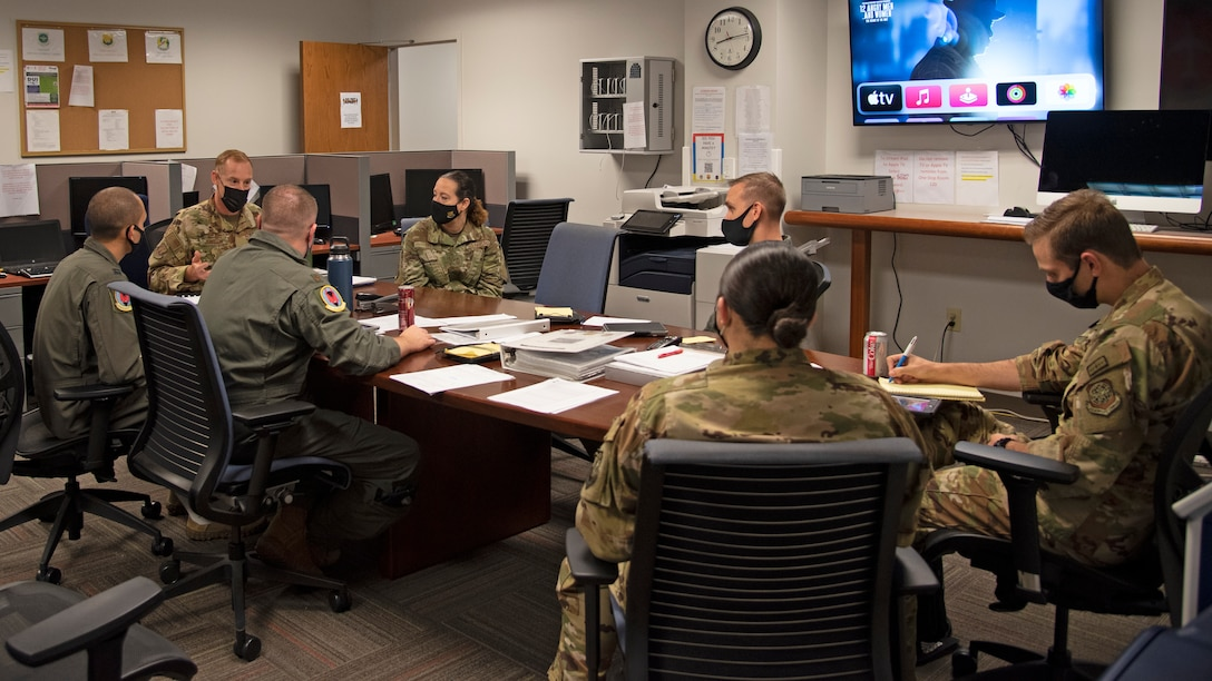 U.S. Air Force Col. Ben Jonsson, 6th Air Refueling Wing commander and Chief Master Sgt. Shae Gee, 6th Air Refueling Wing command chief attend a pre-flight briefing, March 30, 2021, at MacDill Air Force Base, Fla.