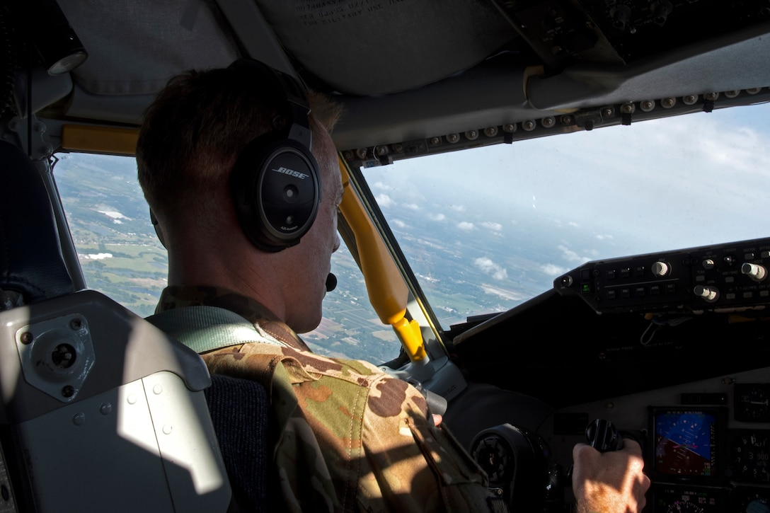 U.S. Air Force Col. Ben Jonsson, 6th Air Refueling Wing commander operates the controls of a KC-135 Stratotanker aircraft, March 30, 2021.