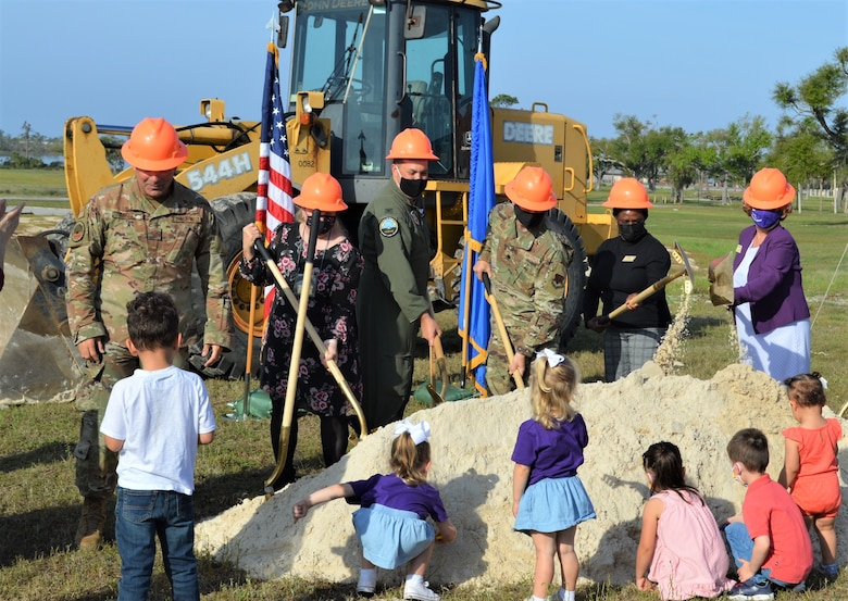 Six future members of the new Tyndall Air Force Base Child Development Center in Florida gather around with their plastic shovels to participate in a groundbreaking ceremony, March 31, 2021.