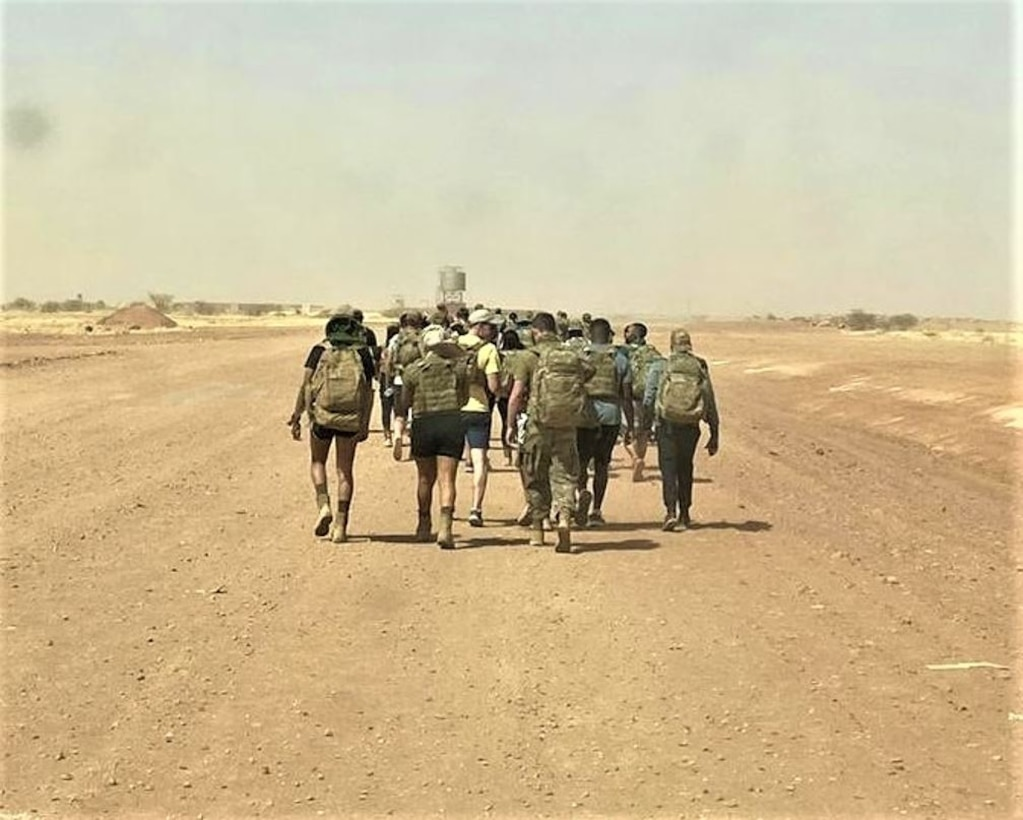 210422-F-XM048-1001 - Members of the 409th ESFS pose for a picture before the beginning of a memorial ruck on March 26, 2021 at Nigerien Air Base 201, Agadez, Niger. Day of the Defender was created to honor the lives  of three lost members from the 412th Security Forces Squadron at Edwards Air Force Base, California, in a three month time span. (Courtesy Photo)