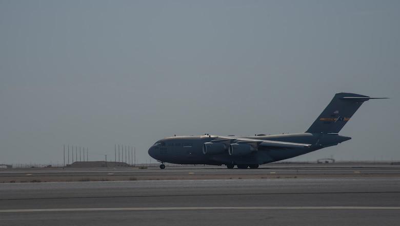 A C-17 Globemaster III assigned to Joint Base Charleston, South Carolina, prepares to takeoff on the runway April 27, 2021, at Al Udeid Air Base, Qatar.