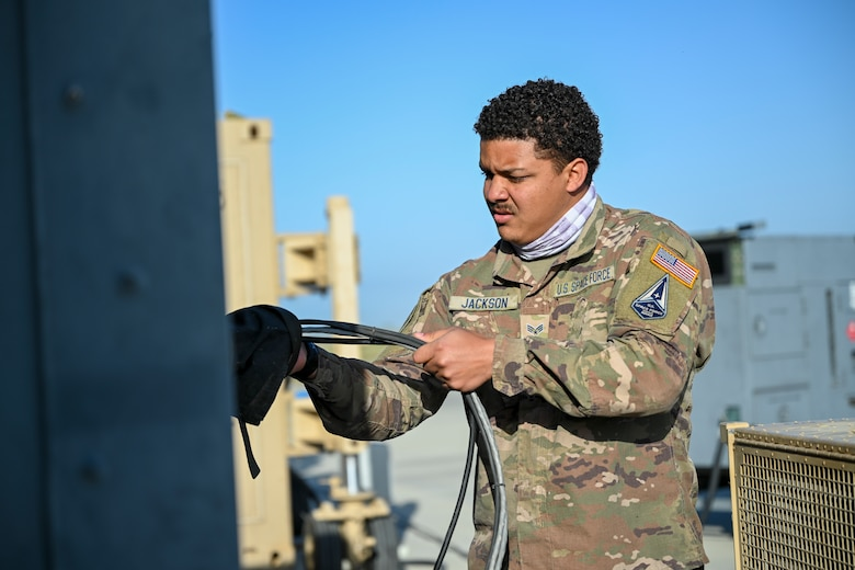 Specialist 3 Bronze Jackson, 49th Aircraft Maintenance Squadron aircraft communications maintenance unit technician, sets up MQ-9 Reaper cockpit power and network capabilities during Exercise Agile Reaper, April 16, 2021, on Point Mugu Air Naval Station, California.  The 49th Wing currently has a small number of U.S. Space Force Guardians who assist with routine missions at Holloman Air Force Base, including MQ-9 maintenance. (U.S. Air Force photo by Senior Airman Kristin Weathersby)