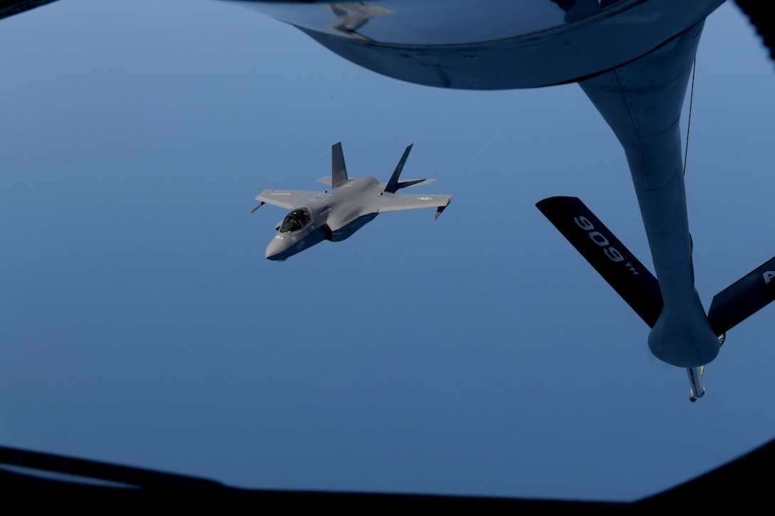 KC-135 from Kadena Air Base, Japan, refuels Marine aircraft during training exercise.