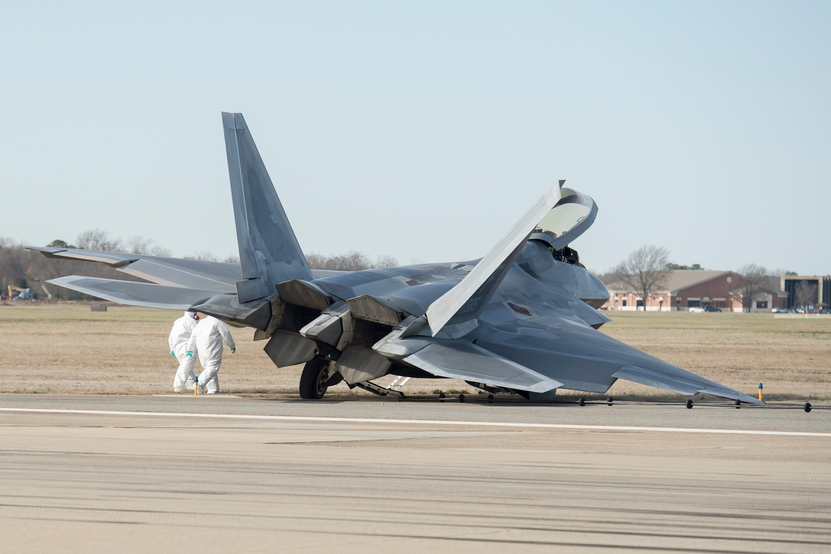 An F-22 Raptor rests on the runway after a mishap