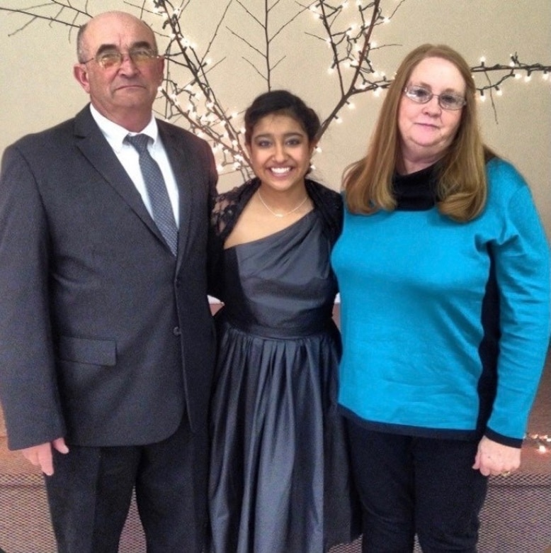 Airman 1st Class Jessica Makenna Martinez Greenlee, 36th Force Support Squadron services journeyman, poses for a photo at her niece's wedding with her parents, Lonny and Donna Greenlee at Spartanburg, South Carolina, Feb. 16, 2014. Greenlee was placed in foster care at the age of three with three of her siblings. After being in a few homes, a couple from Lubbock, Texas showed interest in adopting all four of them, giving them the chance to grow up together with the company of 19 other children they had and adopted. (Courtesy photo)