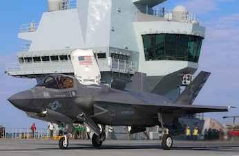 A U.S. Marine conducts carrier qualifications in an F-35B Lightning II Joint Strike Fighter aboard the Royal Navy aircraft carrier HMS Queen Elizabeth (R08).