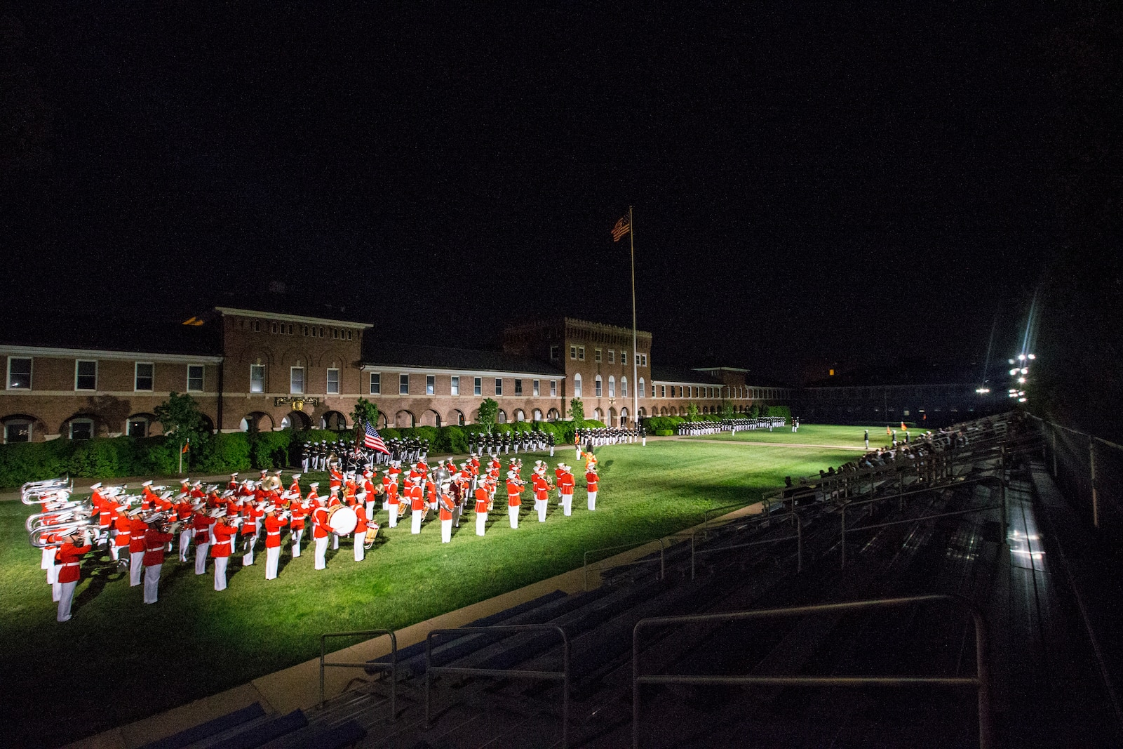 """Marines with Marine Barracks Washington stand at attention during """"march on the colors"""" at the Friday Evening Parade at Marine Barracks Washington, D.C., April 30, 2021."""