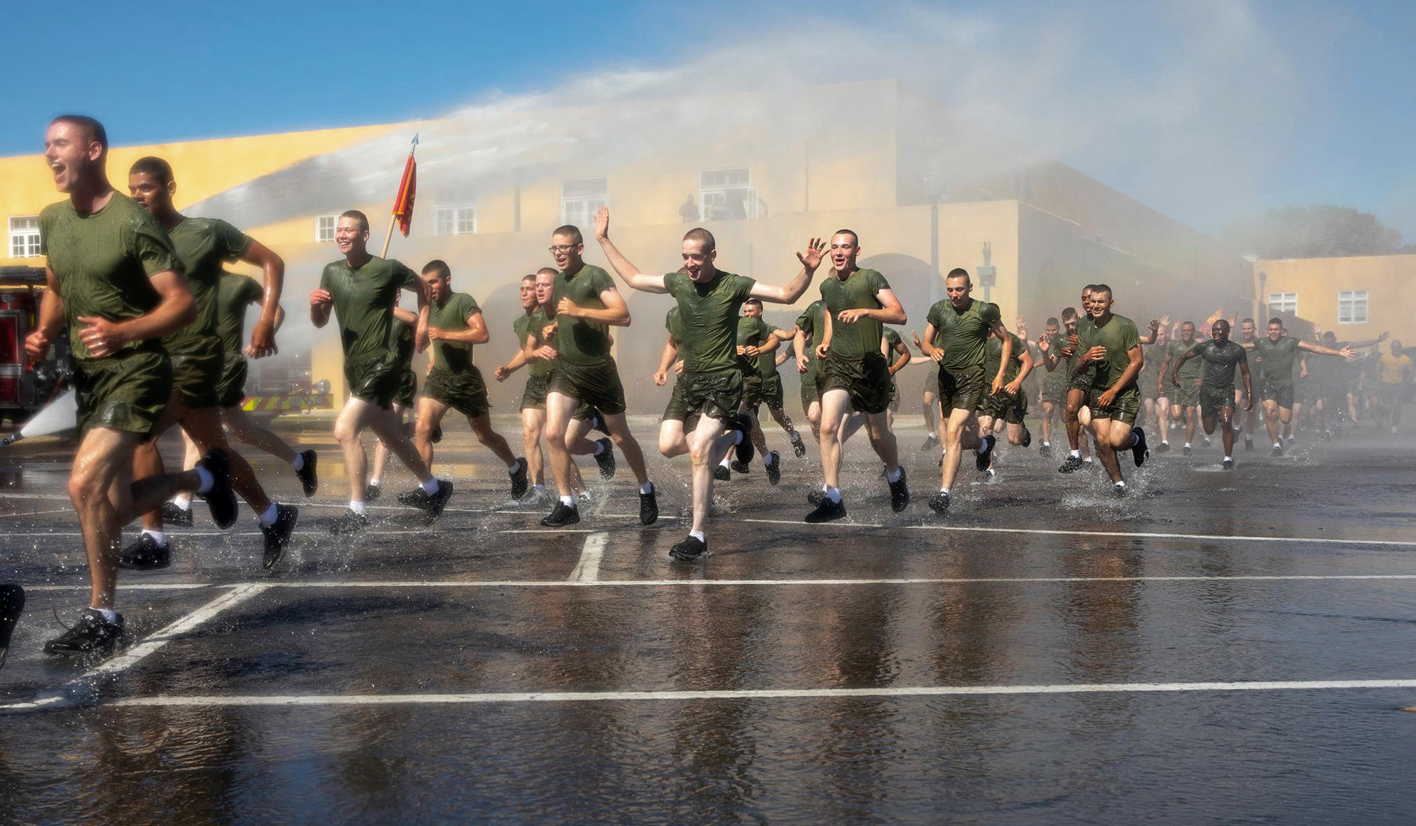 New Marines with Fox Company, 2nd Recruit Training Battalion, participate in a motivational run at Marine Corps Recruit Depot, San Diego, April 28, 2021.