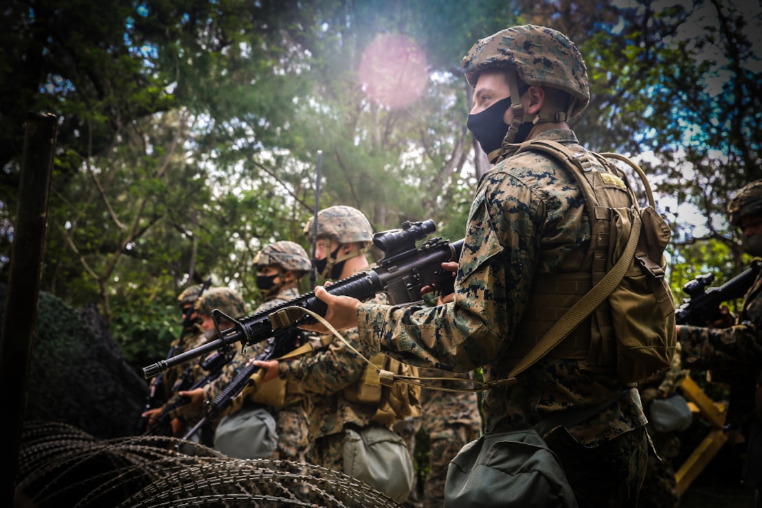 U.S. Marines secure an entry control point during a training iteration for exercise Pacific Pioneer on Kin Blue training area, Okinawa, Japan, April 20.