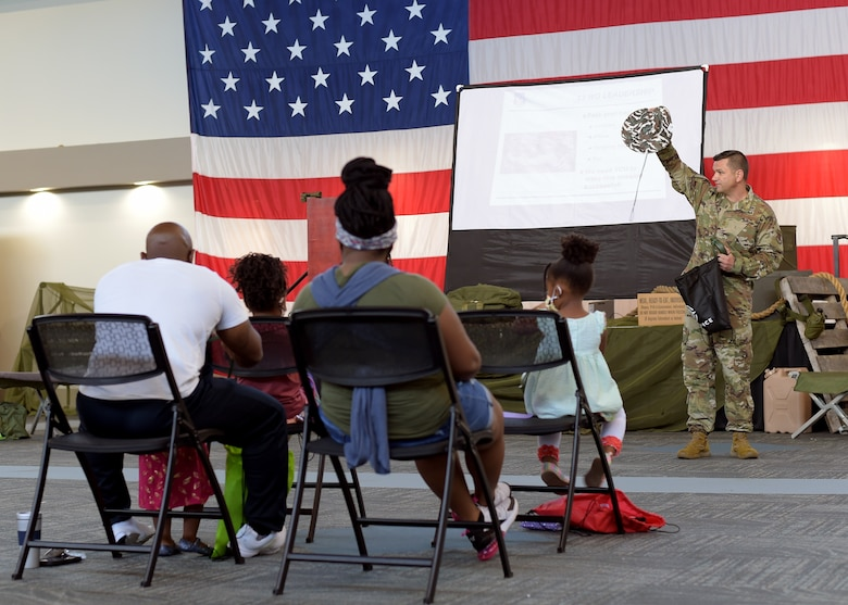 Airman briefing kids at event